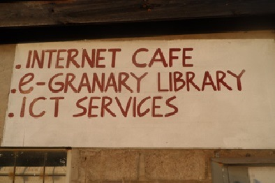 a sign that says internet cafe, e-granary library, and ICT services